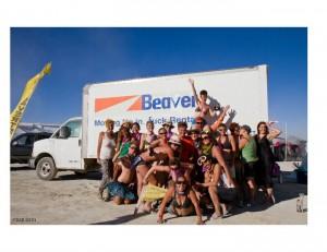 Camp Beaverton for Wayward Girls posing in front of their 18-foot Uhaul at Burning Man 2010
