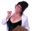 EcoSexual activist, artist and sex educator Annie Sprinkle wearing a white lab coat and geeky, thick rimmed glasses