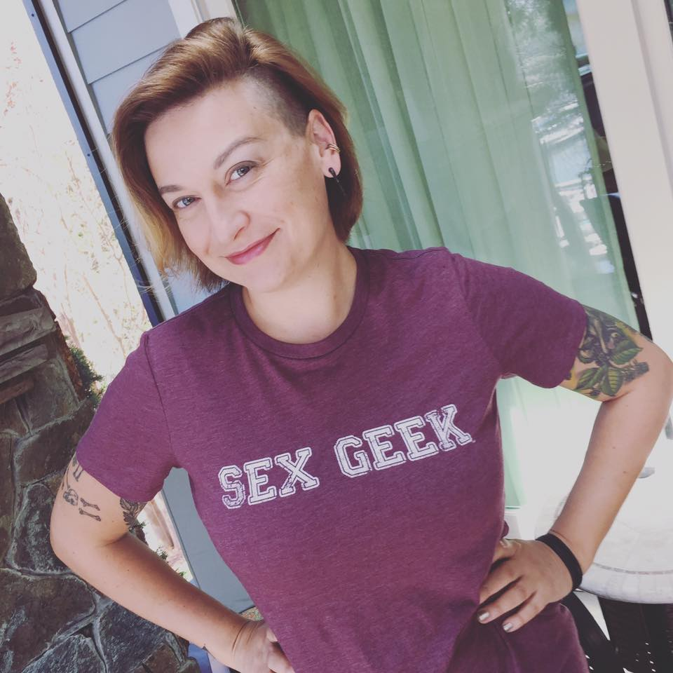 Girl Sex 101 author Allison Moon wearing a heather mulberry color Sex Geek tee from ReidAboutSex.com