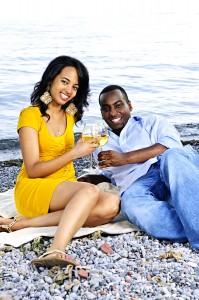 Romanctic, happy couple having wine on beach