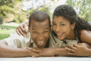 African American Couple Laying