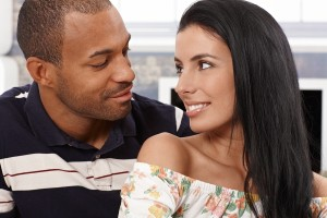 Loving mixed race couple looking at each other just about to kis