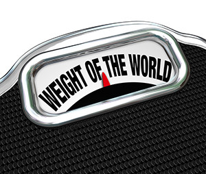 The words Weight of the World on a scale to illustrate trouble,