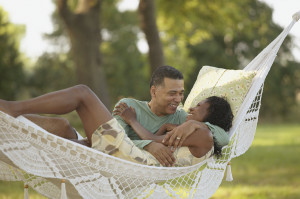 Middle-aged couple hugging in hammock