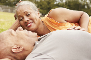 Romantic Senior Couple Relaxing In Park Together