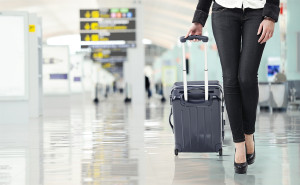 Young Woman Pulling Luggage At The Airport, Close Up Sexy Legs