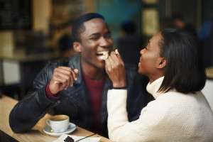 Beautiful dark skinned couple in love having a great time togeth