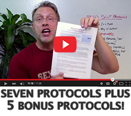 """Image of a YouTube video player of sex and relationship educator Reid Mihalko of ReidAboutSex.com showing to camera his Casual Sex Protocols handout, also known as the Slut Protocols, with the text """"Seven Protocols Plus 5 Bonus Protocols"""" beneath the YouTube player progress bar"""
